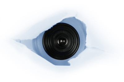 web cam behind a paper hole, concept of spy